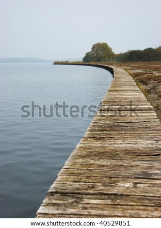 the image shows a landing stage along the coastline - stock photo