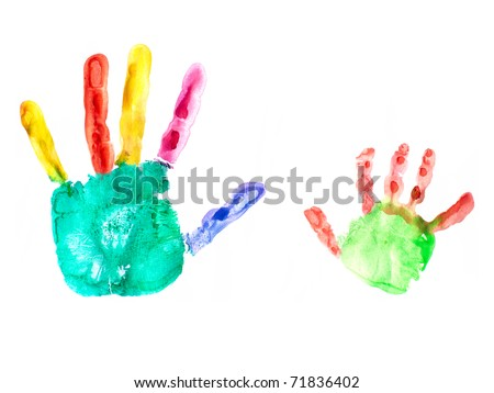 the image shows the imprint of a kids hand and an adults hand - stock photo