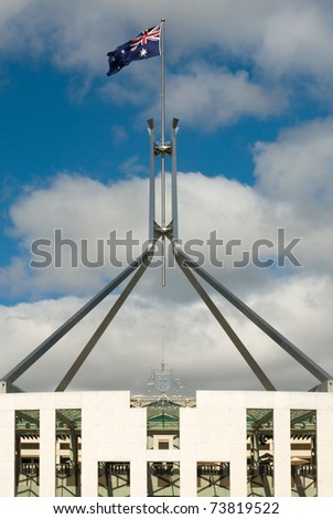 The imposiing structure of the flag pole atop Australia's Parliament House - stock photo