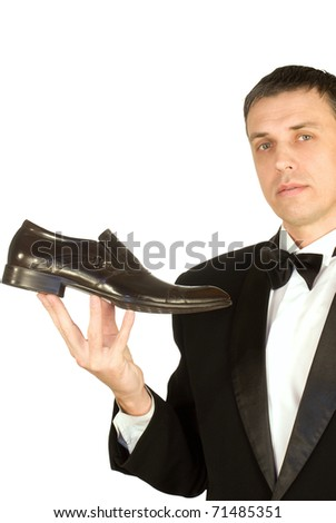 The imposing man chooses elegant footwear - stock photo