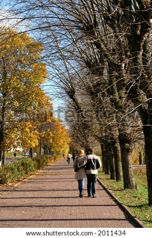 The in love couple walking on autumn park