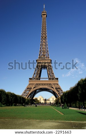 The incredible Eiffel Tower in Paris on a warm summer day.