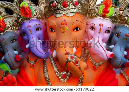 The Indian God Ganesha in a colorful depiction with multiple heads