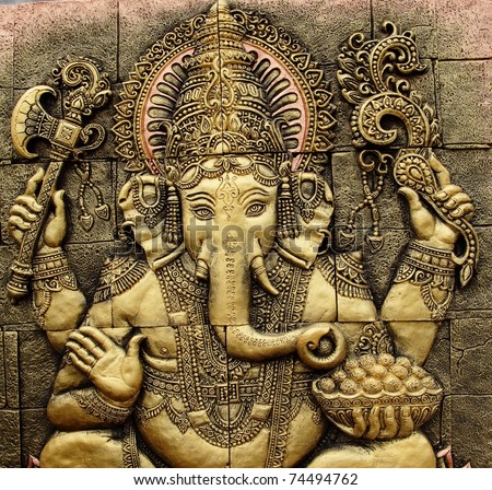 The Indian God Ganesha  made from clay in low relief carving  jig saw image style. - stock photo