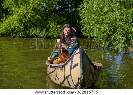 The Indian in the canoe.