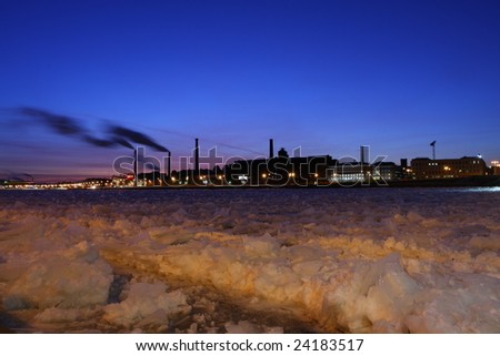 The industrial factories on river bank Neva. The city of St.-Petersburg. Russia.