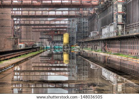 The industrial reflection pool in the deserted Zollverein coking plant in Essen, Germany. - stock photo