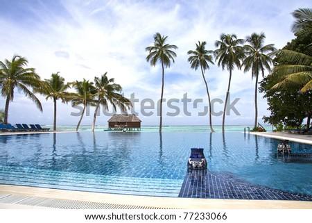 The Infinity pool, Meeru, Maldives, Indian Ocean - stock photo
