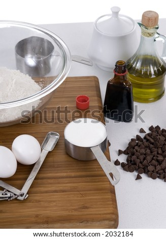 The ingredients for chocolate chip cookies lay on a table - stock photo
