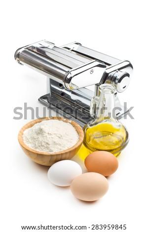 the ingredients for preparing pasta and pasta machine - stock photo