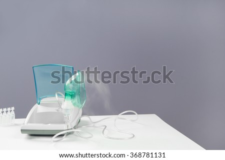 The inhaler on a table in the clinic or at home. /inhaler/medical equipment, - stock photo