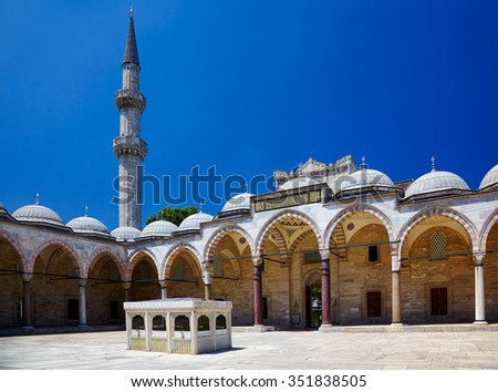 The inner courtyard of Suleymaniye Mosque surrounded by the arched gallery  with ablutions fountain in the center, Istanbul, Turkey