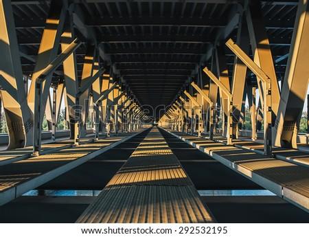The inner part of the unfinished Podolsky bridge at sunset. Kiev. Ukraine. - stock photo
