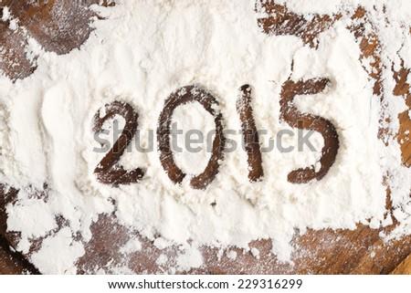 The inscription on the flour: 2015 - stock photo
