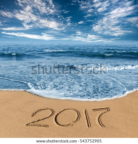 the inscription on the sand 2017 on the beach