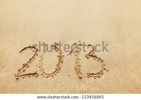 The inscription on the sand - 2013, the new year. Background. - stock photo