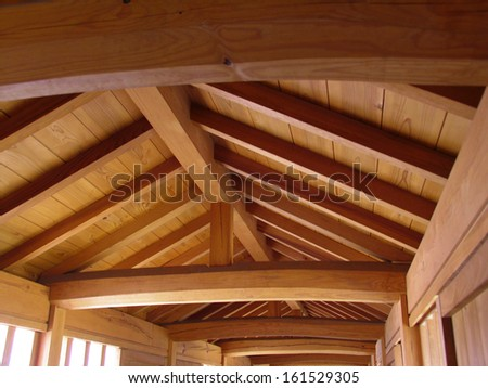 The inside of a building built with wood. - stock photo
