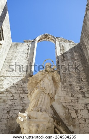 The inside of the Convento do Carmo in Lisbon. This large cathedral built by the Carmelite order and was destroyed during the Lisbon earthquake of 1755 leaving only the bare arches and walls.  - stock photo