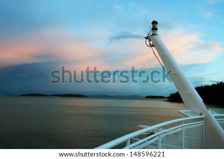 The Inside Passage British Columbia as seem from a BC Ferry front deck, at sunset - stock photo