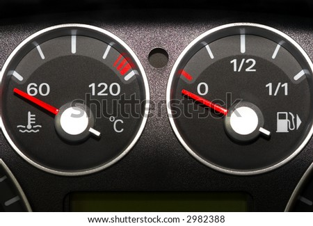 The instrument panel of the car. Red arrow. - stock photo