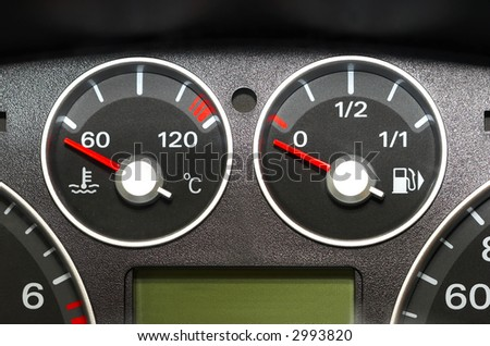The instrument panel of the car. Red arrow.