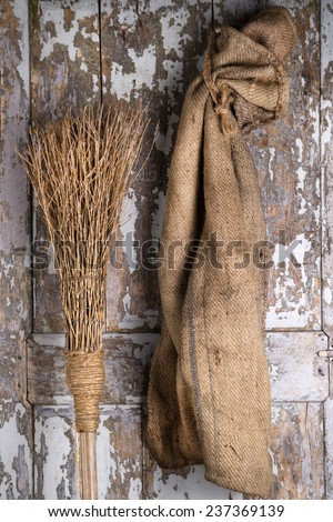 The instruments of work of the Epiphany, magic broom and lots of coal - stock photo