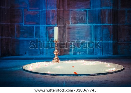 The interior inside the Church in Nuremberg, Germany. The Church is very rich and beautiful, lots of candles, statues, priests. The churches rites, heal the body and soul. Blue, gray dark background - stock photo