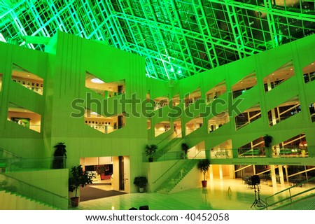 The interior look of the city hall in green lighting, edmonton, alberta, canada - stock photo