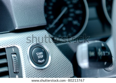The interior of a car focussing on the start/stop button. - stock photo