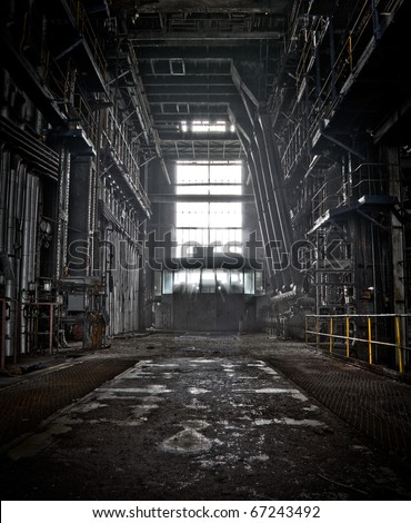 The interior of a machine hall at an abandoned industrial area - stock photo
