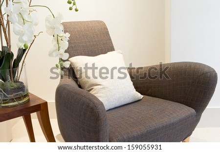 The interior of a modern home, couch and pillow detail - stock photo