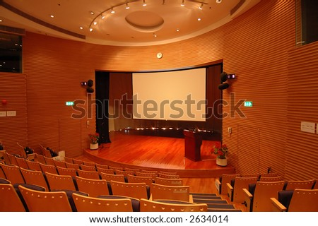 The interior of a theater, the stage and screen - stock photo