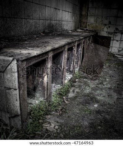 The interior of an abandoned factory, grunge scene - stock photo
