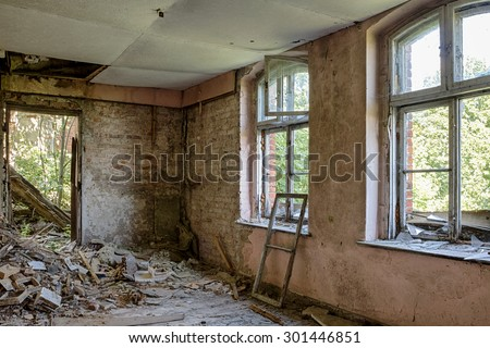 The interior of an abandoned mansion - stock photo