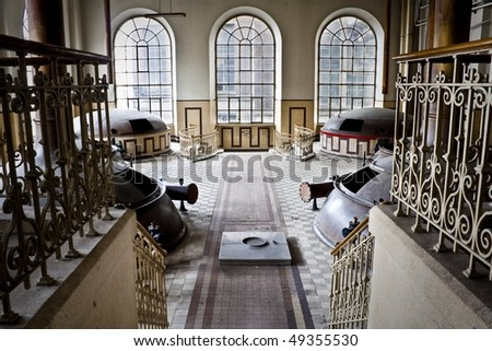 The interior of an old abandoned Beer distellery, an urban place. - stock photo