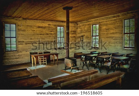 The interior of an old one room school house. It shows the old school desks and benches with a wood stove in middle of the room. This photo has had hdr applied as well as vignette and grunge texture.  - stock photo