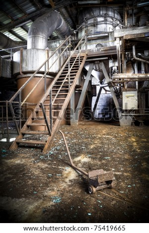 The interior of an production room at an abandoned sugar factory - stock photo