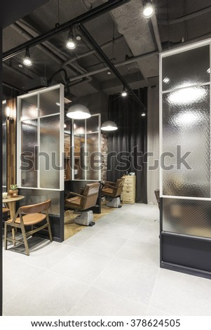 The Interior of modern(organic, vintage, natural) hair salon(beauty parlor, hairdresser's) with chair, red brick, marble bottom