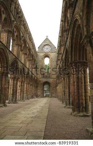 The interior of the abbey in Jedburgh. Jedburgh Abbey is a ruined 12th century Augustinian abbey, situated in Jedburgh, in the Borders of Scotland. The abbey was founded in 1138. - stock photo