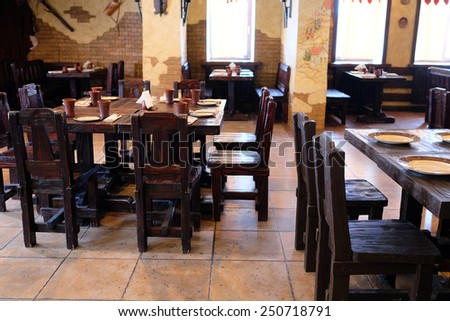The interior of the restaurant in the old Russian style - stock photo