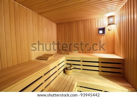 The interior of the sauna - shelves, window, lamp, nobody - stock photo