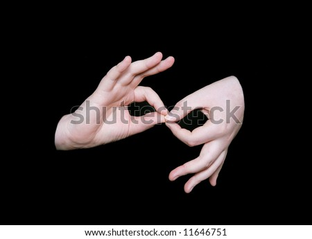 the interpreting sign in sign language on a black background - stock photo
