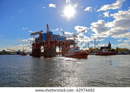 The introduction of a drilling rig to a shipyard for repairs. Photo taken on: October 12, 2010 - stock photo