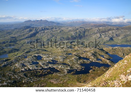 The inverpolly nature reserve in northern Scotland, looking north from Suilven Mountain. - stock photo