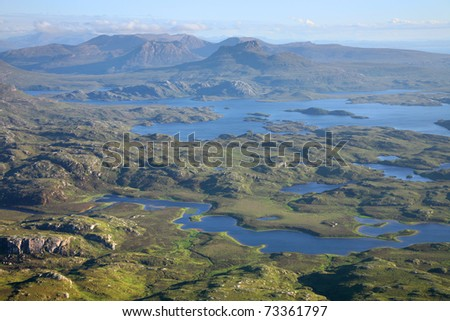 The inverpolly nature reserve in northern Scotland, with Stac Pollaidh mountain in the background. - stock photo