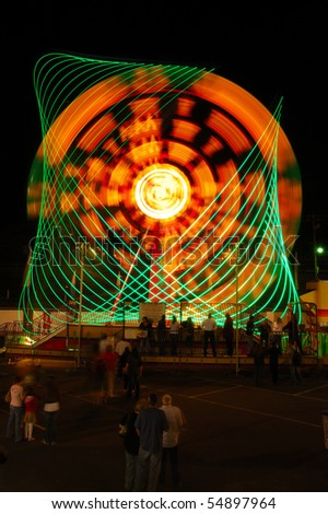 The Invertor ride as part of the midway at the 2009 Douglas County Fair in Roseburg Oregon at night. - stock photo