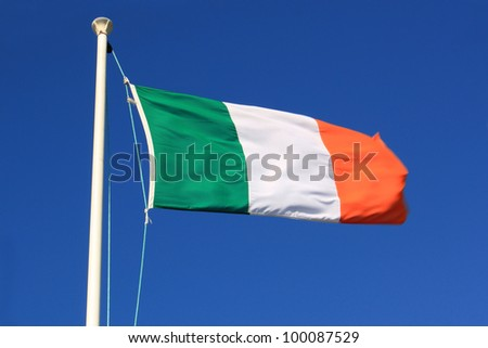 The Irish flag caught in a strong wind.