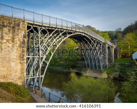 The Iron Bridge over the River Severn in the Ironbridge Gorge, Shropshire, England, UK. A 30 metre span of cast iron built in 1779. - stock photo