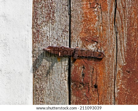 The iron latch on a wooden door - stock photo