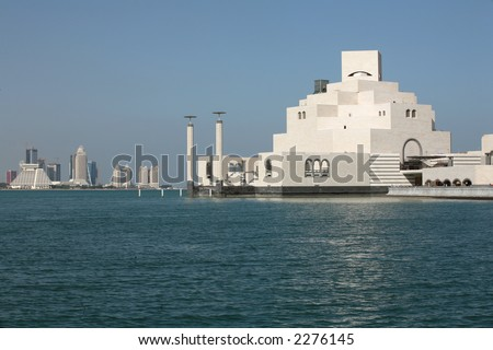 The Islamic Art Museum in Doha Bay, with some of the high-rise New District seen in the background - stock photo